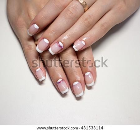beautiful french manicure with diamonds - stock photo