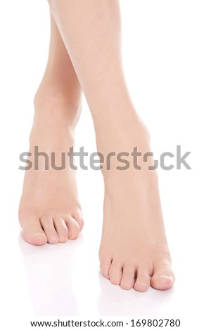 Beautiful fresh, clean feet with pedicure. Isolated on white.