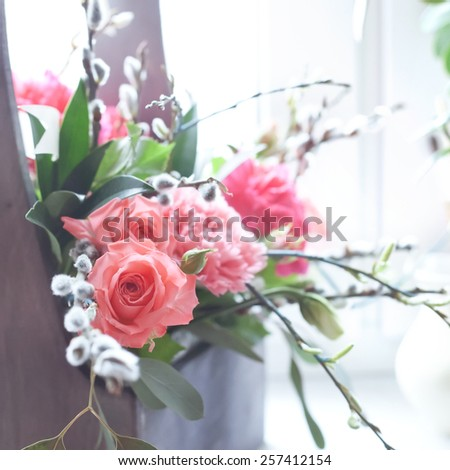 Beautiful fresh flowers in a wooden box, natural light setting, toned photo - stock photo