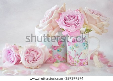 Beautiful fresh pink roses in a beautiful box on a light background . - stock photo