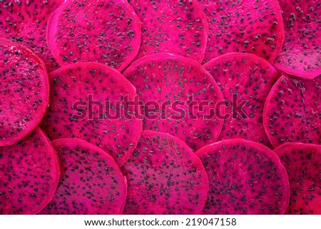 beautiful fresh sliced red dragon fruit  as background, Pitaya is the plant in Cactaceae family or Cactus - stock photo
