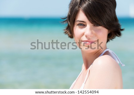 Beautiful fresh woman over the beach background