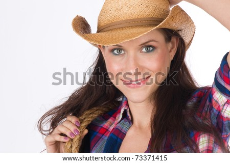 Beautiful Fresh Woman wearing Cowboy Hat Showing off her Cowgirl - stock photo