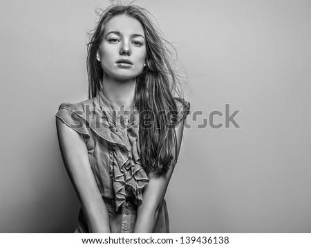 Beautiful friendly girl. Studio photo. Black-white photo. - stock photo