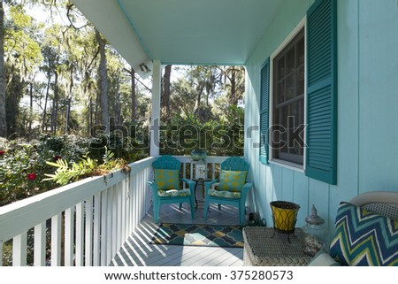 Beautiful front porch looking out onto forest