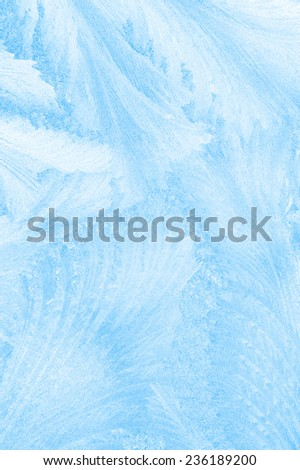 Beautiful frosty pattern on glass - stock photo