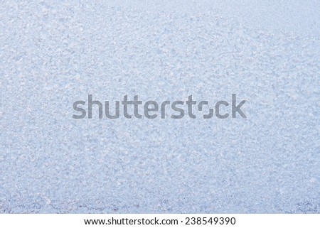 Beautiful frosty pattern on glass - can be used as a background.  - stock photo
