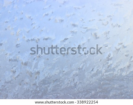 Beautiful frosty pattern on glass - can be used as a background.