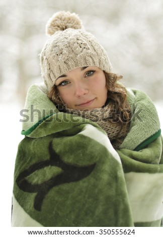 Beautiful,frozen,nice,attractive,cine,cute,young,smiling,pretty,happy girl,woman roll up,wrapped up green,warm plaid,blanket in severe,cold,snow winter,warm up,comfort,hold,sick,coverlet,scarf,cute  - stock photo