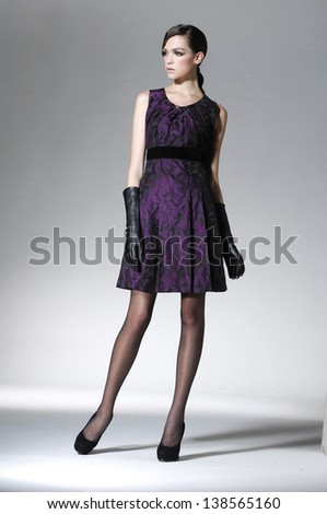 Beautiful full body young fashion model posing light background - stock photo