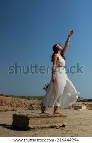 Beautiful fullbody Greek goddess with arms up - stock photo