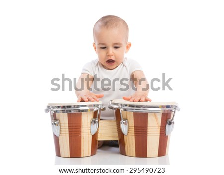 Beautiful funny baby child playing drums and singing isolated