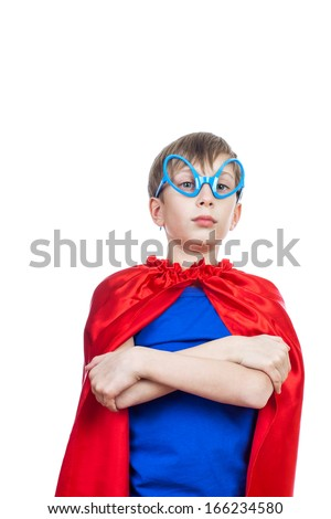 Beautiful funny child pretending to be superhero standing, looking strong and powerful   (superhero concept) - stock photo