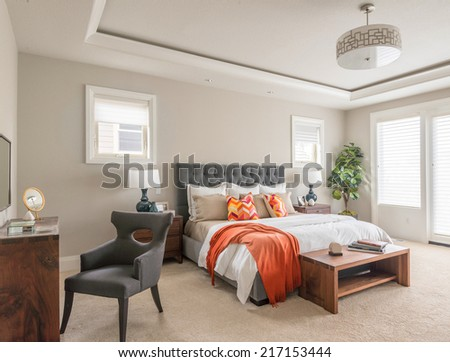 Beautiful Furnished Bedroom in New Luxury Home - stock photo