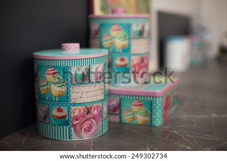 Beautiful furniture with tableware and decor,kitchen with vintage metal boxes - stock photo
