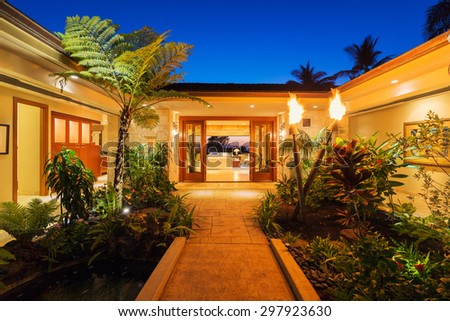 Beautiful Garden Entrance to Luxury Home  - stock photo