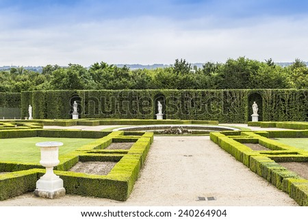Beautiful garden in a Famous palace Versailles. The Palace Versailles was a royal chateau. It was added to the UNESCO list of World Heritage Sites. Paris, France.