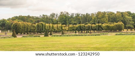 Beautiful garden in summer of the Castle Fontainebleau - stock photo