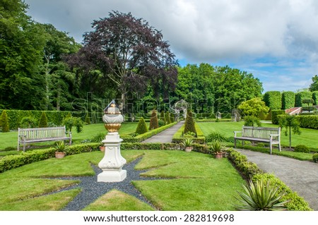 beautiful garden of the old mansion Menkemaborg - stock photo