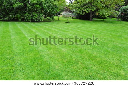 Beautiful Garden with a Fresh Mown Lawn - stock photo