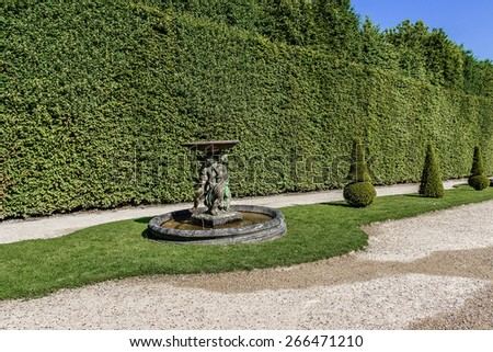 Beautiful Gardens of famous Versailles palace. The Palace of Versailles was a royal chateau. It was added to the UNESCO list of World Heritage Sites. Paris, France. - stock photo