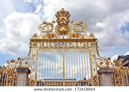 Beautiful gate of Versailles palace detailed fence in front of royal palace entrance - Golden fence of Versailles near Paris  by the day - stock photo