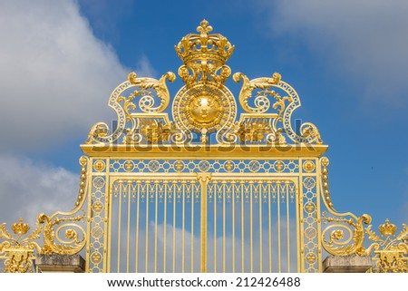 Beautiful gate of Versailles palace detailed fence near Paris isolated on white background- Golden fence of Versailles details - stock photo