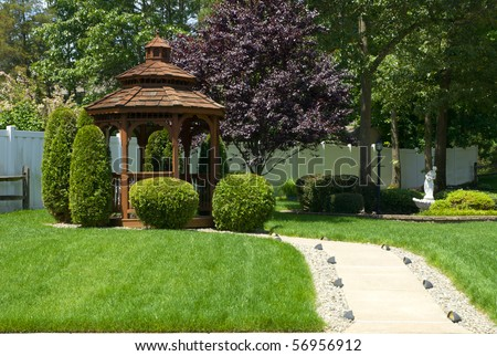 Beautiful gazebo on a front yard - stock photo