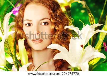 Beautiful gentle girl with red hair among the flowers.    - stock photo