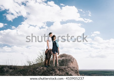 beautiful gentle loving couple against the sky in a mountainous area