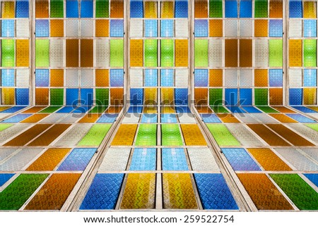Beautiful geometric pattern of colorful stained glass window.