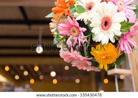 beautiful gerbera flower bunch with light decoration in wedding ceremony day - stock photo