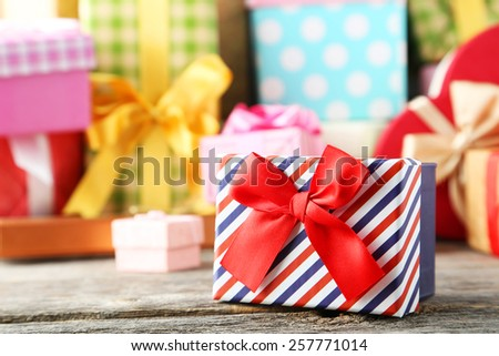 Beautiful gift box on grey wooden background - stock photo