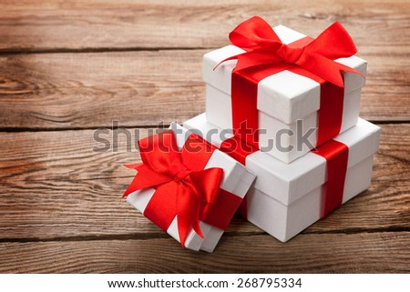 Beautiful gift box with a red bow - stock photo