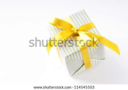 beautiful gift box with yellow ribbon over white background isolated