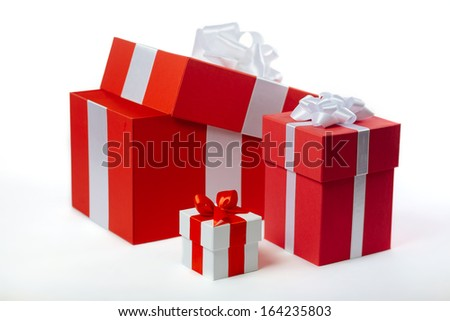 Beautiful gift red-white boxes on white, isolated on white