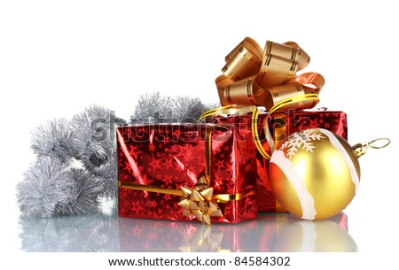 beautiful gifts with gold bows and Christmas ball isolated on white