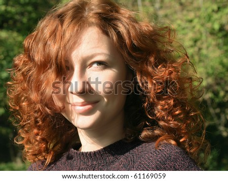 Beautiful ginger girl with long wavy hair - stock photo
