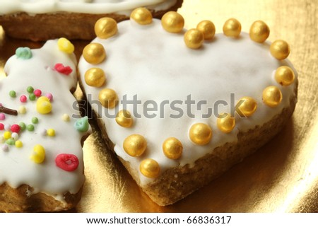 Beautiful gingerbread heart with golden sugar pearls