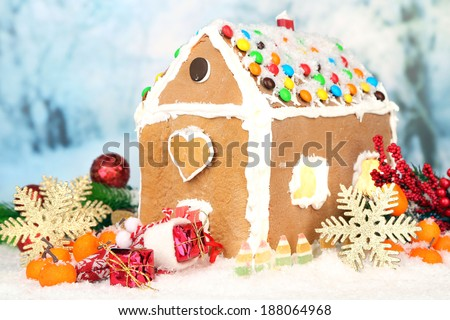 Beautiful gingerbread house with Christmas decor - stock photo