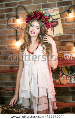 Beautiful girl acrobat, magician's assistant behind the scenes of the circus arena - stock photo