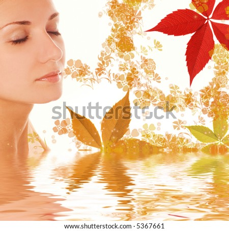 Beautiful girl and colorful autumn leaves in rendered water - stock photo