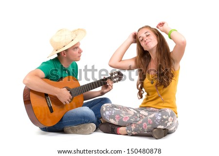 Beautiful girl and handsome boy with a guitar on a white background - stock photo