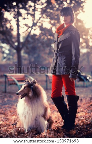 Beautiful girl and her dog in the park