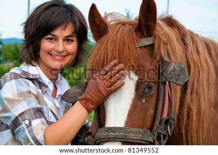 beautiful girl and her handsome horse - stock photo