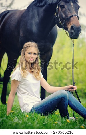 Beautiful girl and horse in spring forest - stock photo