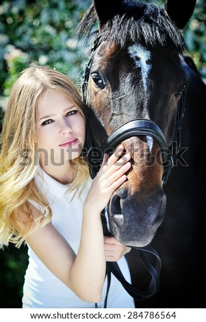 Beautiful girl and horse in spring outdoor - stock photo