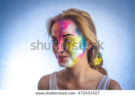 Beautiful girl and paint on the face, body art,  smile, wonder, emotion