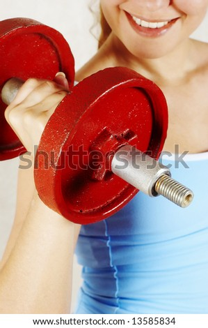 beautiful girl and red dumbbell