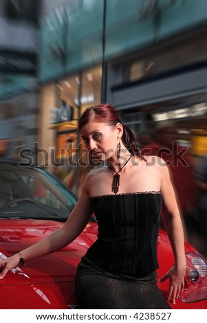Beautiful girl and the red sports car. - stock photo